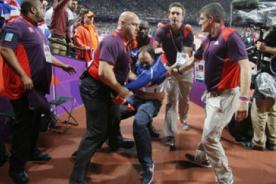 Londres 2012 : Detienen a persona que lanzó botella en final de Usain Bolt