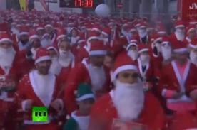 Miles de 'Papás Noel' corren en calles de Madrid para conseguir regalos - VIDEO