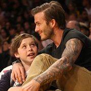 David Beckham y Tom Cruise se lucen al lado de sus hijos en partido de béisbol