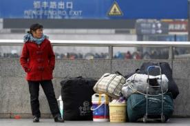 Chinos aprovechan el Año Nuevo Lunar para viajar por el mundo