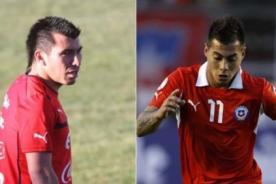 Chilenos Medel y Vargas suspendidos de su selección por escaparse
