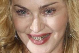 Madonna luce dentadura hecha de oro y diamantes