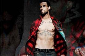 Adam Levine luce su tonificado cuerpo en la revista 7 Hollywood - Fotos